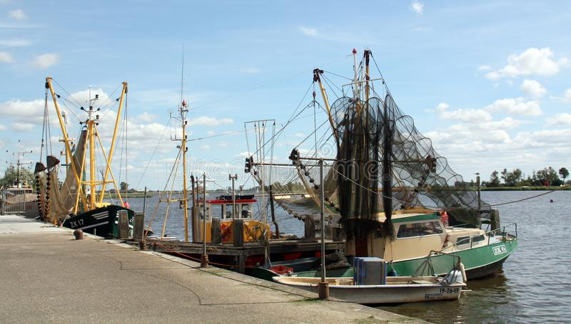 Fishing boats in the harbour royalty free stock images