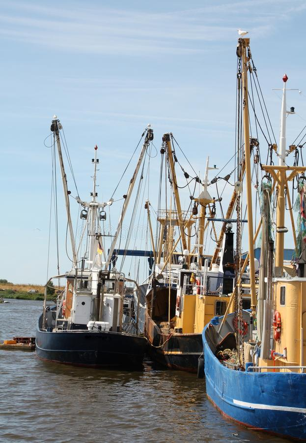 Fishing boats in the harbour stock images