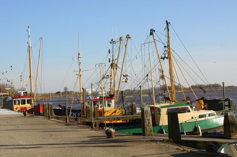 Fishing boats in Zoutkamp stock image