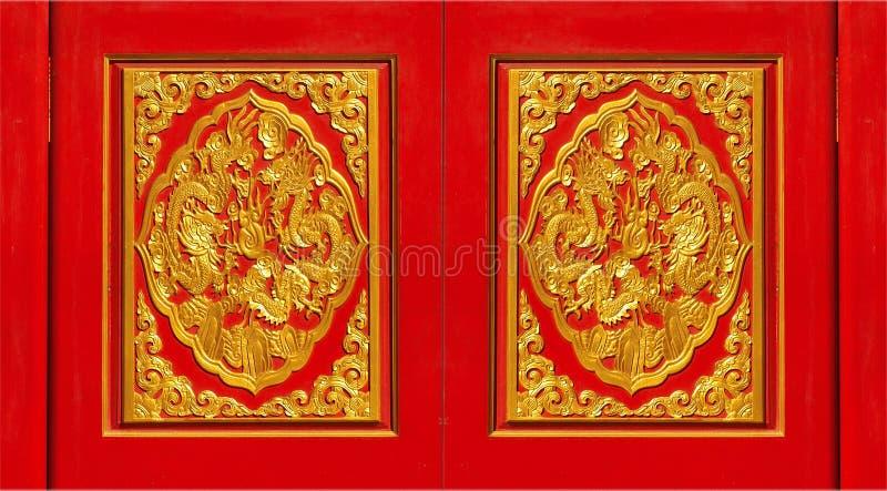 Zręcznie wykonujący ręcznie czerwoni i złoci panel fotografia stock