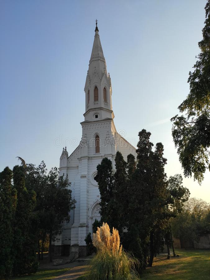 Zrenjanin Serbia white protestant church. Great sunny weather in autumn provided us with this photo stock photography