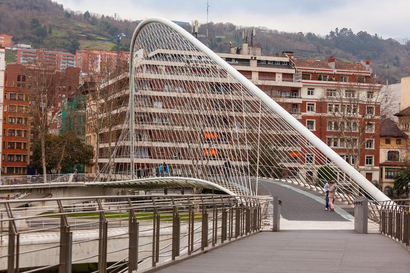 Zubizuri, the Campo Volantin Bridge, Bilbao, Spain. The Zubizuri, the Campo Volantin Footbridge in Bilbao, Spain, modern pedestrian tied arch crossing of the royalty free stock photo