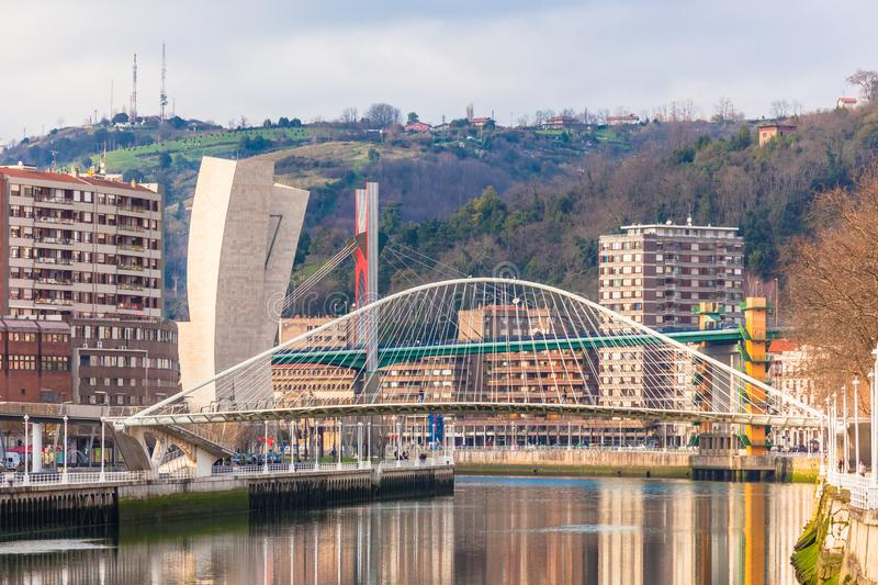 Zubizuri, the Campo Volantin Bridge, Bilbao, Spain. The Zubizuri, the Campo Volantin Footbridge in Bilbao, Spain, modern pedestrian tied arch crossing of the stock photo