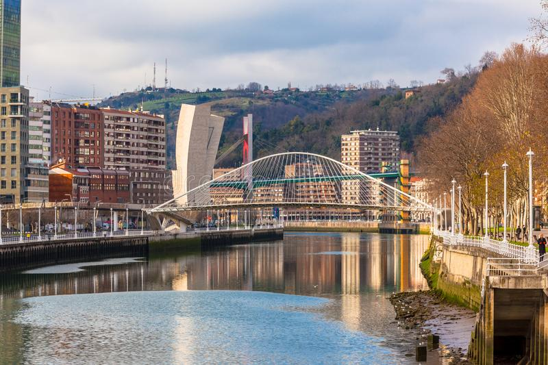 Zubizuri, the Campo Volantin Bridge, Bilbao, Spain. BILBAO, SPAIN - JANUARY 06, 2013: The Zubizuri, the Campo Volantin Footbridge in Bilbao, Spain, modern royalty free stock photo