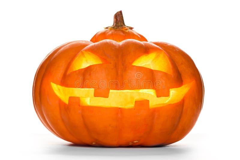 Zucca di Halloween isolata su priorità bassa bianca immagini stock
