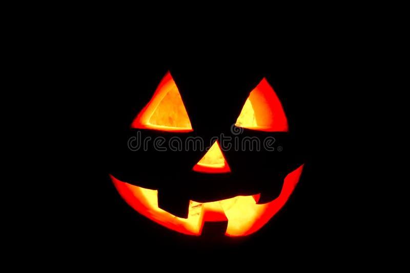 Zucca divertente di Halloween isolata su un'incandescenza nera del fondo da fotografie stock