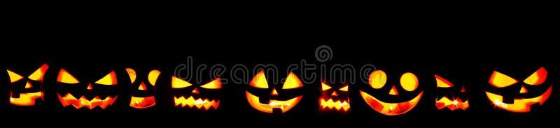 Zucche di Halloween sul nero fotografie stock libere da diritti