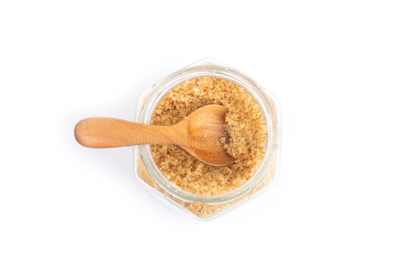 Zucchero bruno in un barattolo di vetro immagini stock libere da diritti