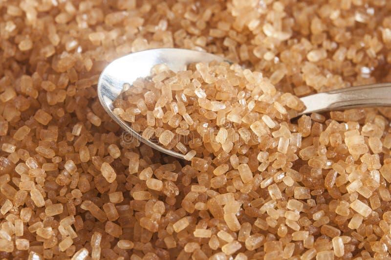 Zucchero di Brown in cucchiaio d'argento immagini stock libere da diritti