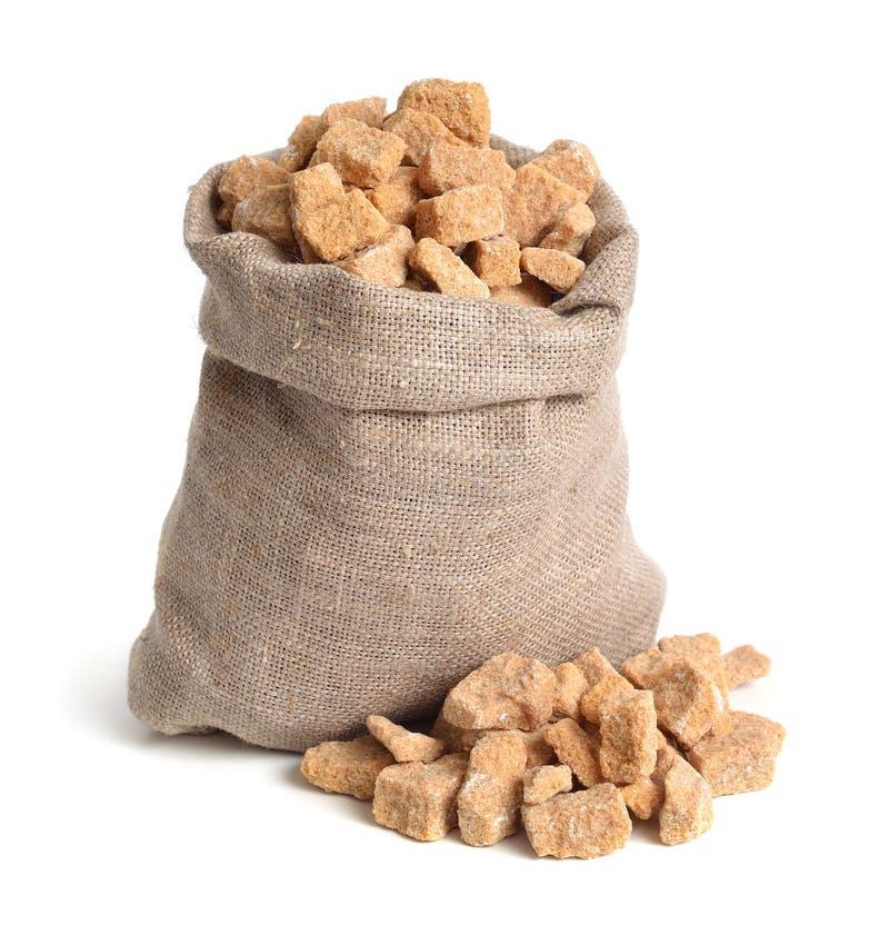 Zucchero di canna di Brown Isolato su priorità bassa bianca fotografia stock libera da diritti