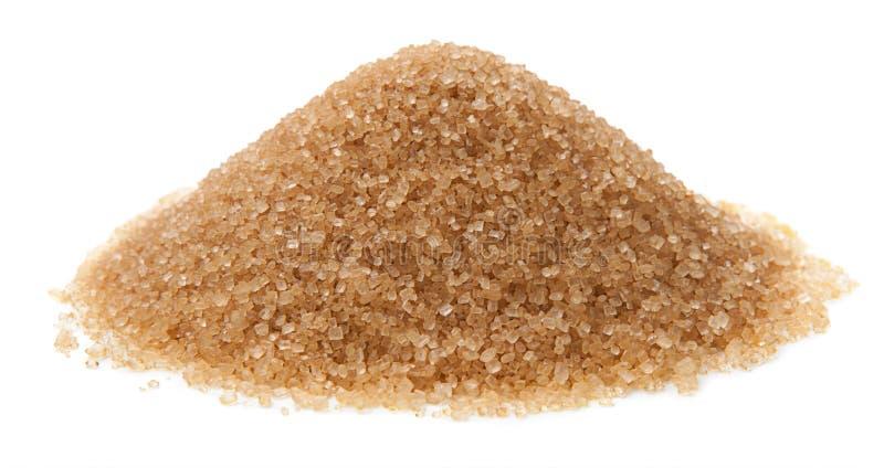 Zucchero di canna isolato su fondo bianco immagini stock
