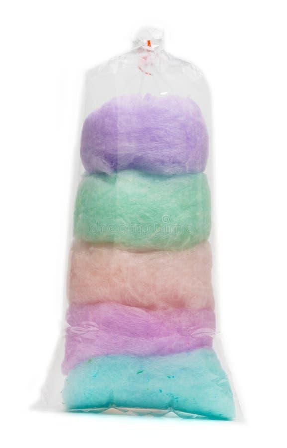 Zucchero filato nel sacchetto di plastica isolato su fondo bianco immagine stock libera da diritti