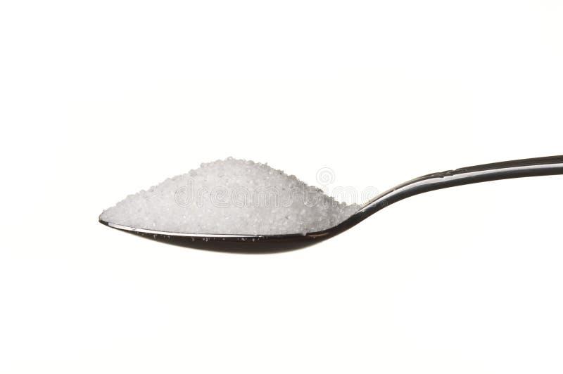 Zucchero in un cucchiaio fotografie stock libere da diritti