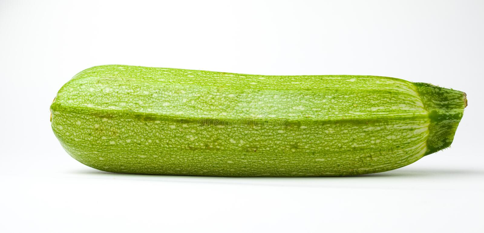 Zucchini. Sliced zucchini on white background royalty free stock image