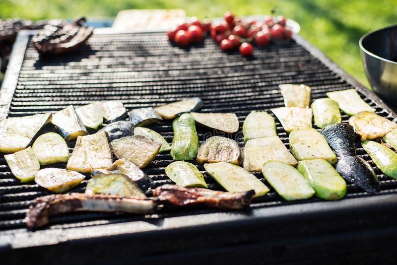 Zucchini and aubergines in on a grill royalty free stock photo