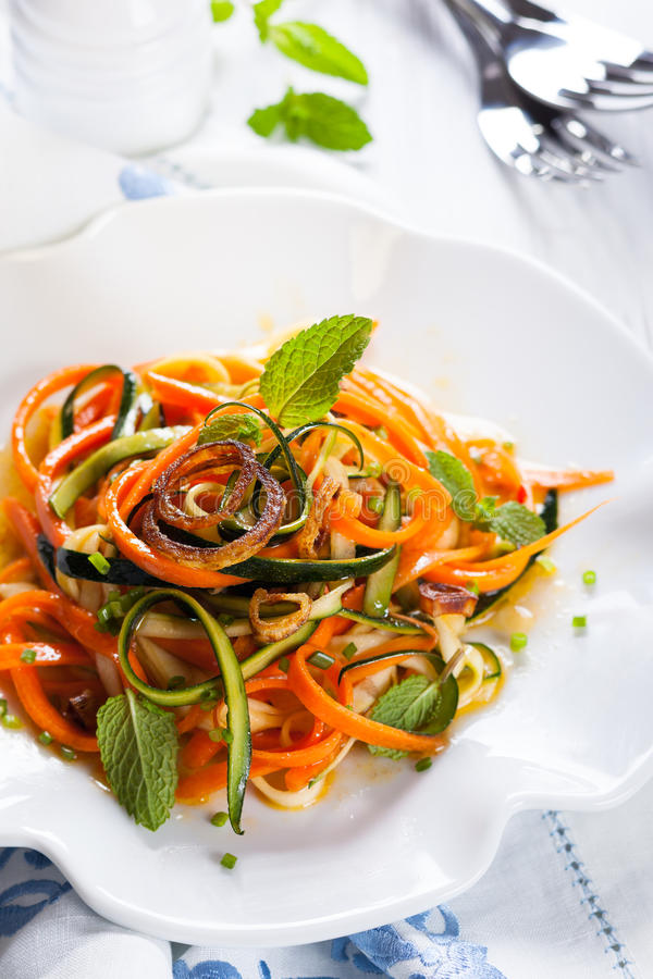 Zucchini and carrot salad. With spicy dressing royalty free stock photos