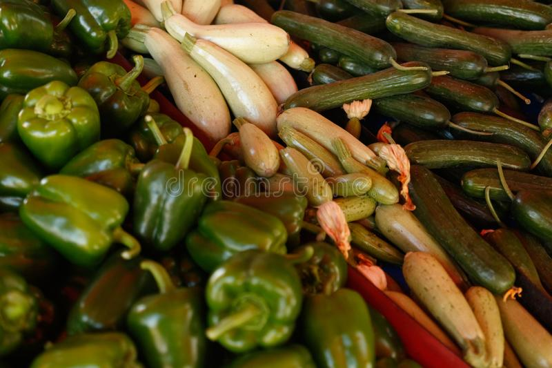 Zucchini, cucumbers and peppers on a shopping arcade. royalty free stock image