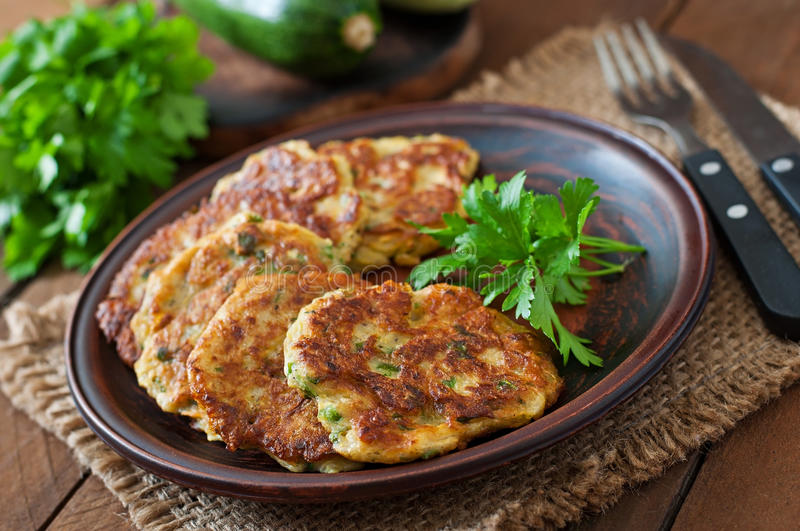 Zucchini pancakes with parsley stock photo