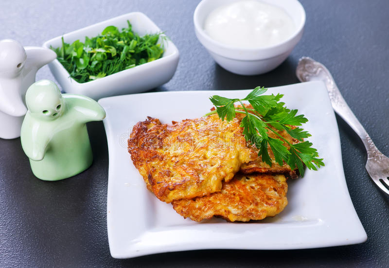 Zucchini pancakes royalty free stock photos