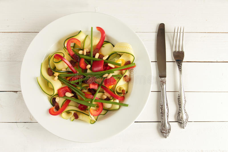 Zucchini salad on white plate stock image