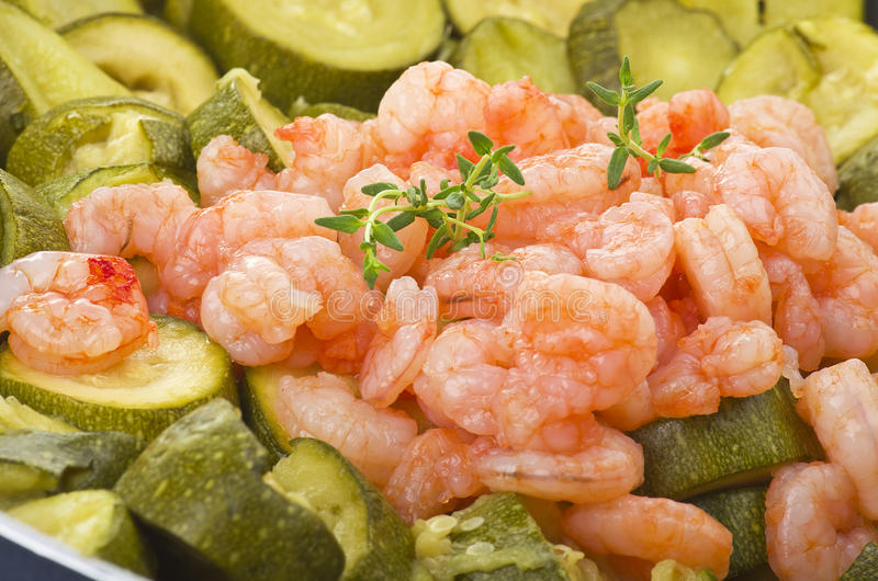 Zucchini and shrimps stock photos