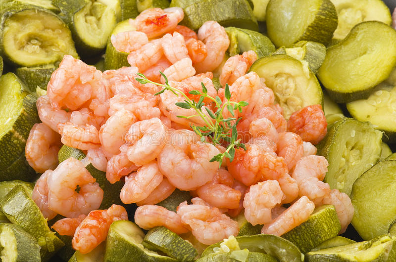 Zucchini and shrimps stock images