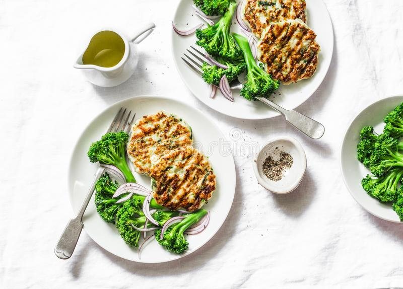 Zucchini turkey burgers and broccoli on a white background, top view. Healthy balanced food concept. royalty free stock images