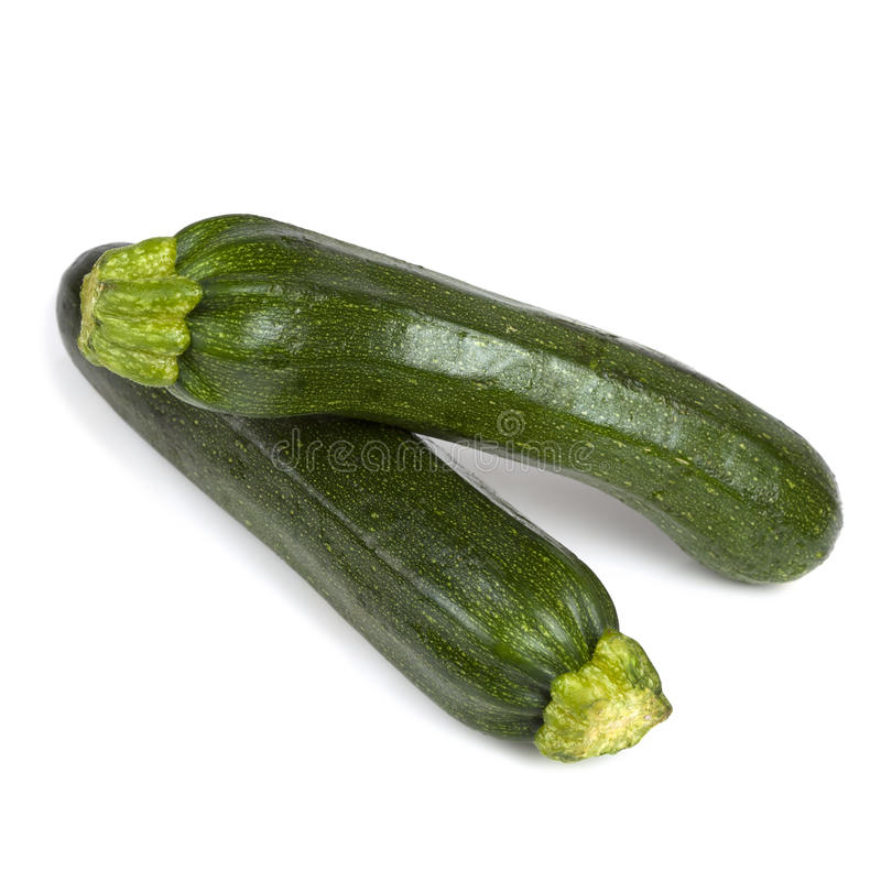 Zucchini två över White royaltyfria bilder