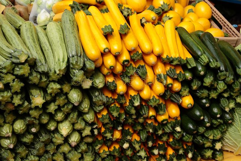 Zucchini vegetables. Zucchini of different colors and varieties on sale royalty free stock photos