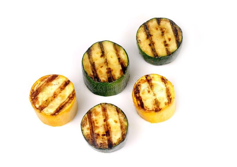 Zucchini verde e giallo su una griglia fotografia stock libera da diritti