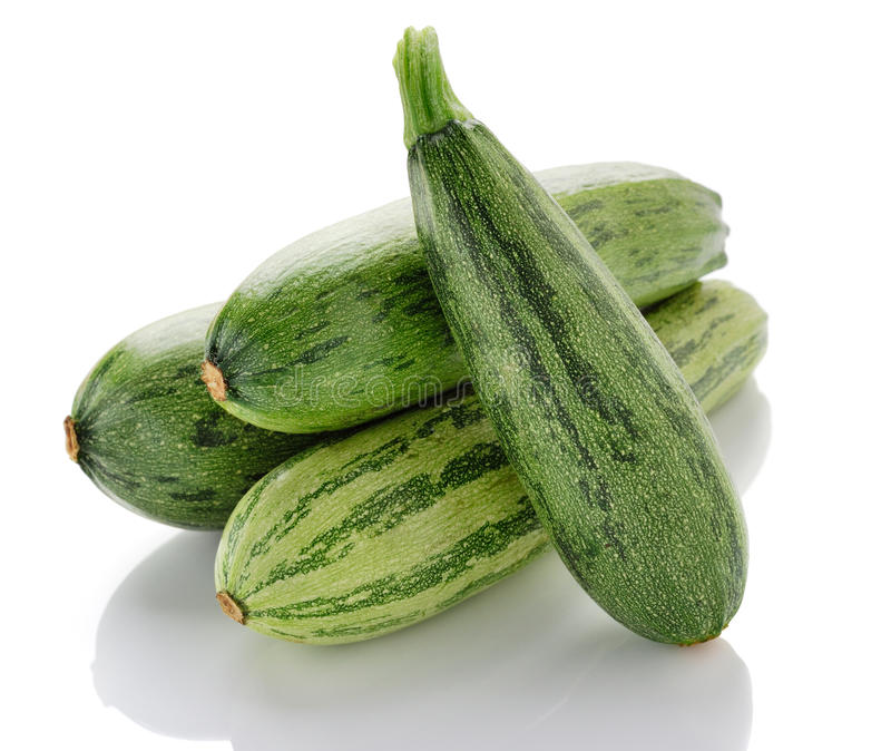 Zucchinis. Two fresh zucchini isolated over white background royalty free stock photography