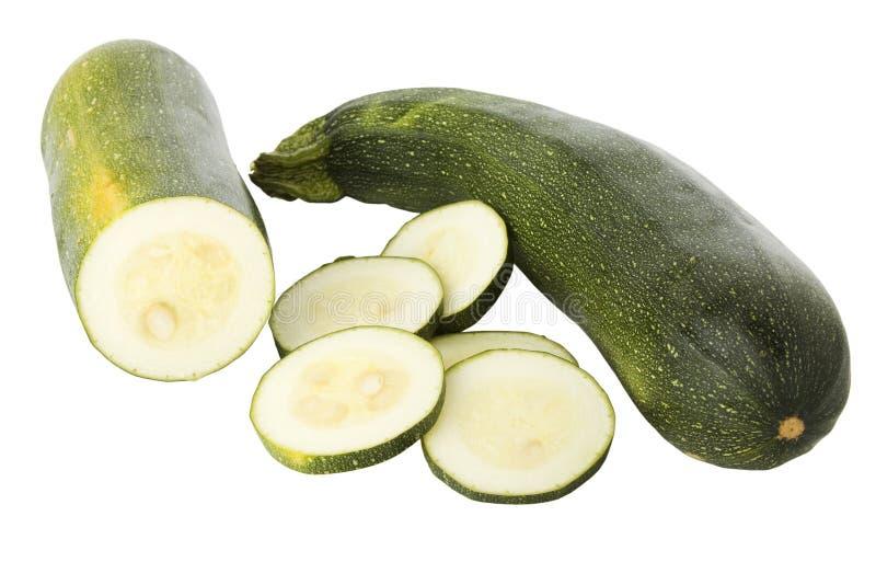 Zucchinis ou courgettes cortados fotos de stock