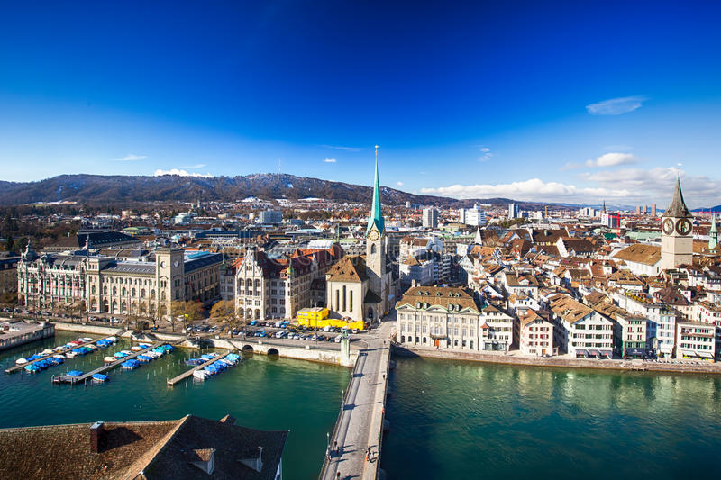 ZUERICH, SWITZERLAND - February 11, 2016 - View of historic Zurich city center with famous Grossmunster Church, Limmat river and stock image