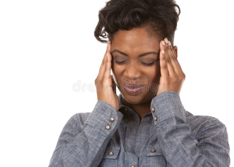 Frau und Kopfschmerzen stockfotos