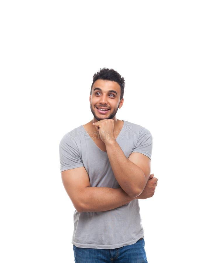Zufälliger Griff Chin Look Up Smiling des gutaussehenden Mannes lizenzfreie stockfotografie