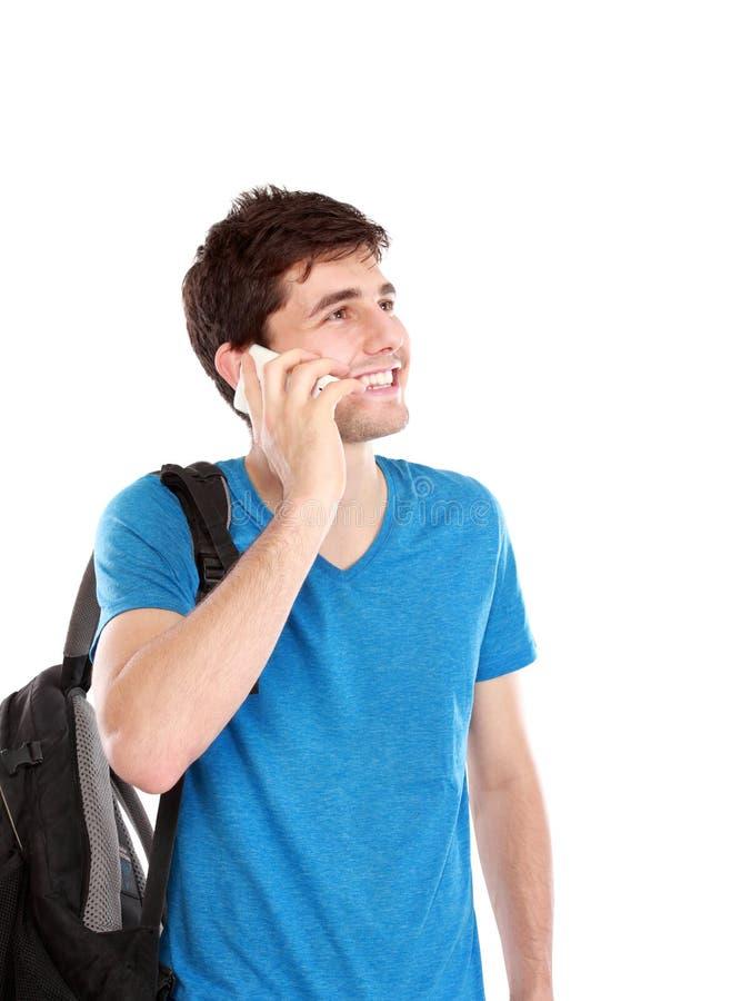 Zufälliger junger Mann, der am Telefon spricht stockbilder