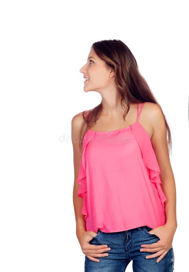 Zufälliges hübsches Mädchen im Rosa stockfoto