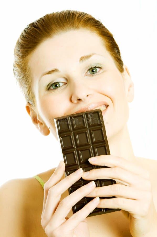 Zufriedenstellung eines Schokolade Craving stockbild