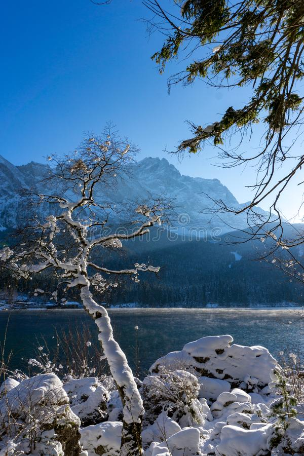 Zugspitze and lake Eibsee in winter royalty free stock photos