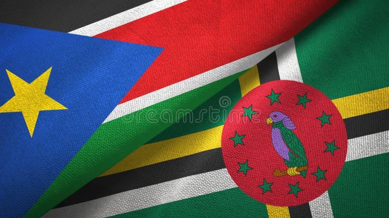 Zuid-Soedan en Dominica twee vlaggen textieldoek, stoffentextuur royalty-vrije stock afbeelding