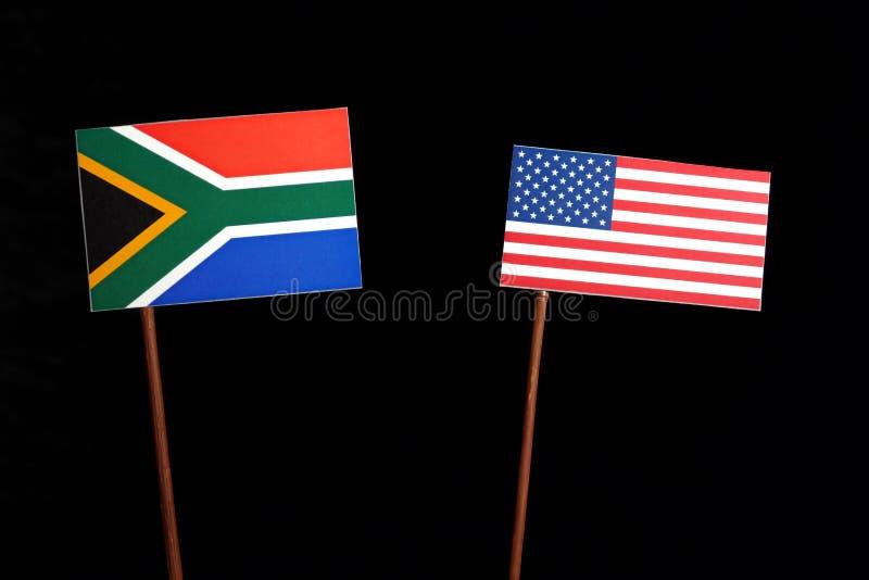 Zuidafrikaanse vlag met de vlag van de V.S. op zwarte stock afbeelding