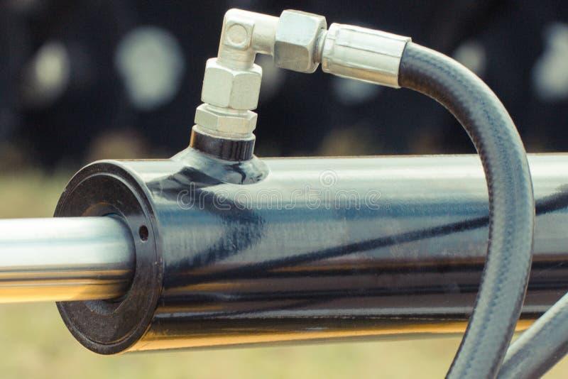 Zuiger of actuator van hydraulisch en pneumatisch machines, technologie en techniekconcept stock foto