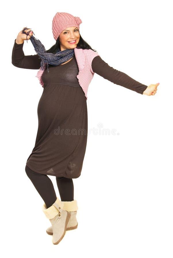 Zujubelnde schwangere Frau stockfoto