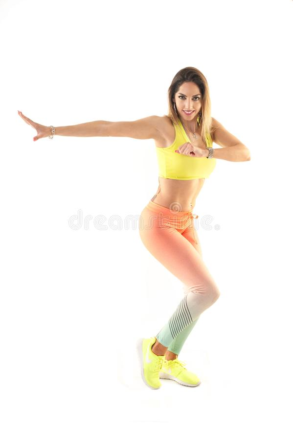 Zumba dance fitness instructor doing sport aerobic exercises. Motivational coach. Indoor training royalty free stock photo