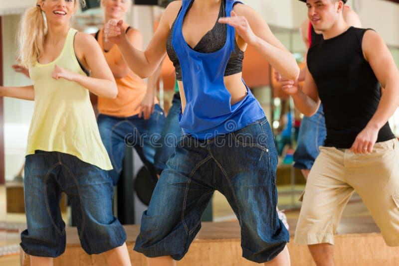 Zumba or Jazzdance - young people dancing stock photography