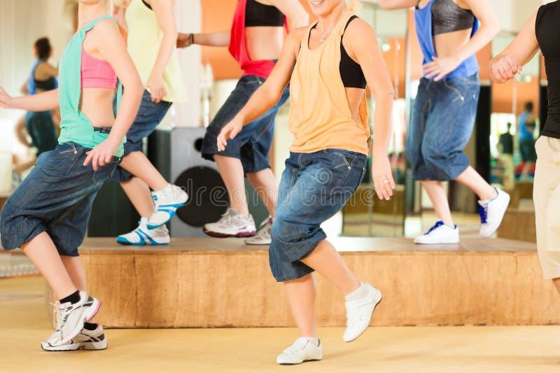 Zumba or Jazzdance - young people dancing in studio royalty free stock photography