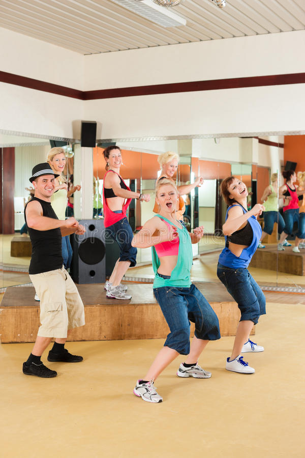 Zumba or Jazzdance - young people dancing in studio stock photography