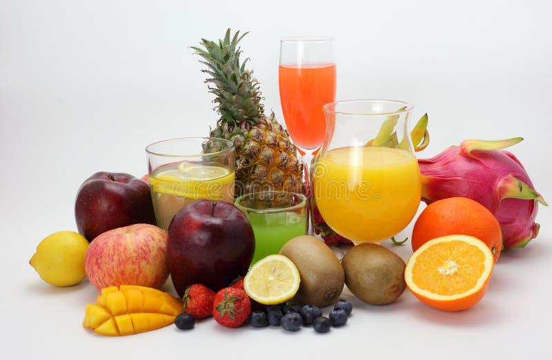 Zumo de fruta y fruta foto de archivo libre de regalías