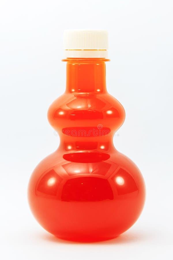Zumo de naranja en botella imágenes de archivo libres de regalías