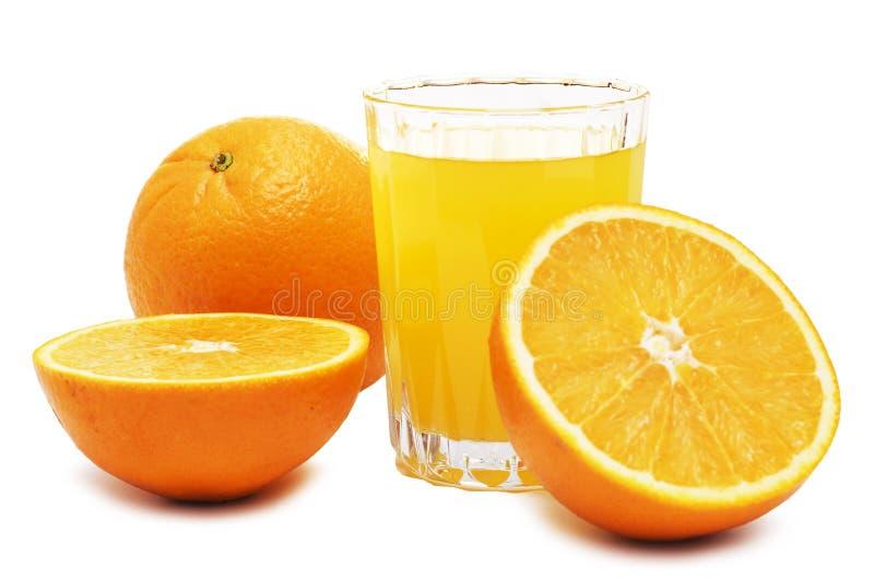 Zumo y frutas de naranja fotografía de archivo libre de regalías